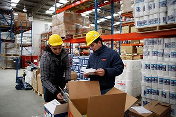 image of warehouse workers following safety procedures